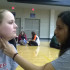Freshman Bri Vargas takes sophomore Caroline Hunt's pulse from the carotid artery during the blood pressure lab.