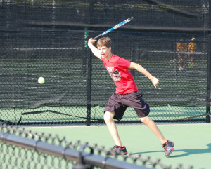Sophomore Cole Bennett returns the ball to his opponent during tennis practice.