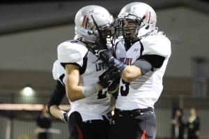 Aaron Fuller and Chochy Luce celebrate after a Lovejoy touchdown.
