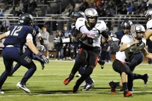 Chochy Luce runs through the Wylie East defense for a gain.