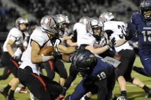 Aaron Fuller tries to escape the Wylie East kickoff team.