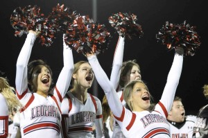 Cheerleaders celebrate after the Alma Mater.
