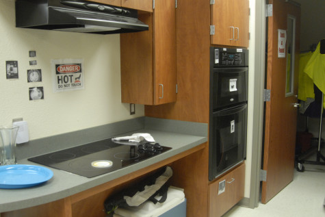 A stove, a microwave, an oven, and a dish washer are a few of the many features of the life skills room.