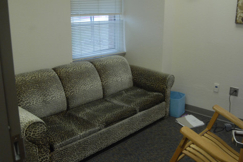 """The """"Calm Down"""" room also features a large, comfortable leopard print couch that the students can relax on."""