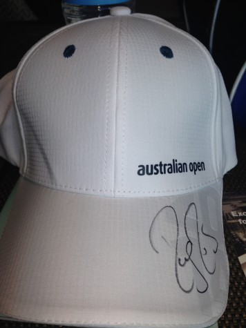 Tennis star Roger Federer signed junior Clarisa Salinas' hat when they met on a casual encounter at the Australian Open.
