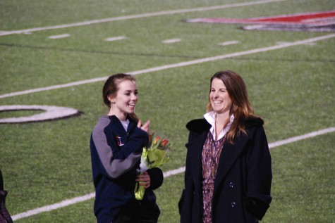 Student Ashley Fahey and the teacher she elected, Amy Paige, share a laugh on the field to celebrate their accomplishments.
