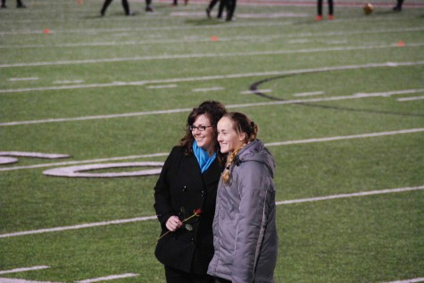 eacher Amanda Glorioso and her student share a moment on the field after being chosen to show all the great times they've had together as teacher-student.