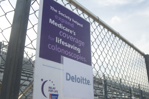 Signs lined the track to provide information about Cancer and to promote local businesses on Friday, April 11, 2014.