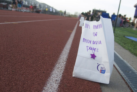 Luminaria lines the track prior to the opening ceremony on Friday, April 11, 2014.