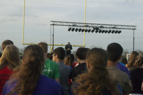 Students listen to Fairview Mayor, Darion Culbertson, speak at Relay for Life on Friday, April 11, 2014.