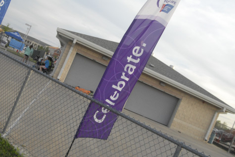 Signs show the purposes of Relay for Life on Friday, April 11, 2014.