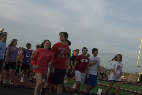 Students take their first lap of Relay on Friday, April 11, 2014.