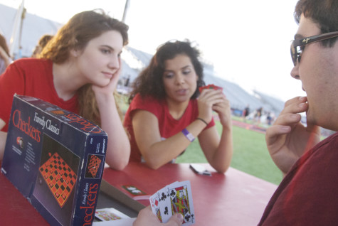 Connor Cross, Stephanie Thompson, and Rachel Segal enjoy a game of cards during Relay for Life on Friday, April 11, 2014.