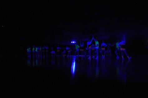 Cheerleaders perform their routine during the Black Light Pep Rally Friday, April 11, 2014.