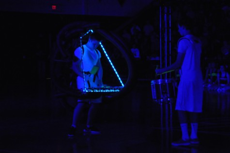 Senior Mason Olk and Junior Cole Stretcher perform their percussion routine during the Black Light Pep Rally Friday, April 11, 2014.